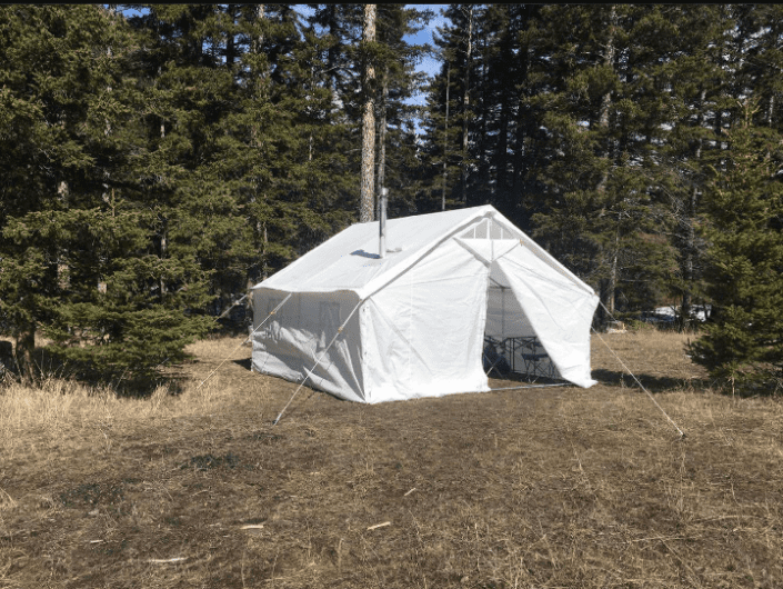 canvas tents with a stove
