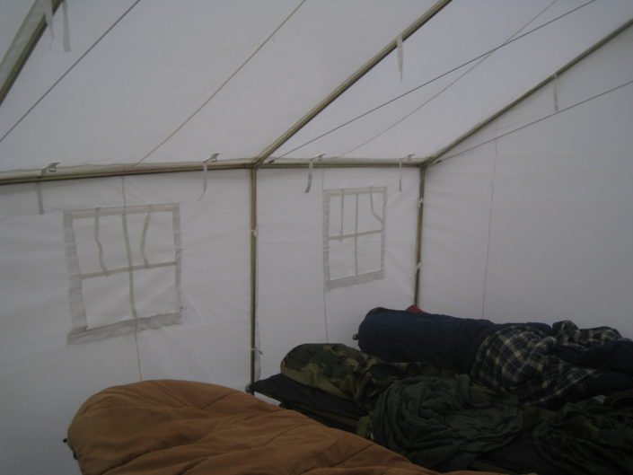 sleeping in a canvas tent