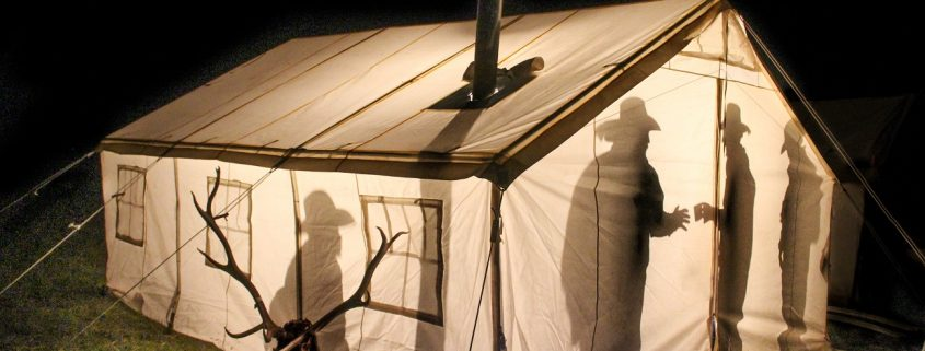 hunters in canvas tent