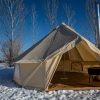 inside bell tent in snow with stove