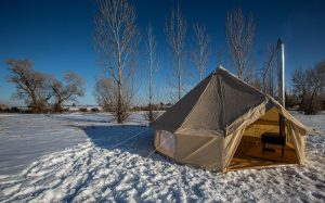 bell tent in snow with window